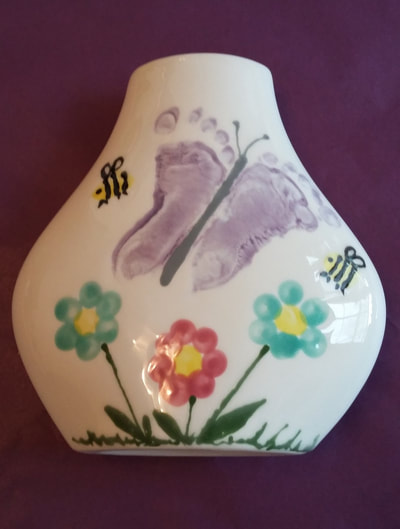 Flat vase with butterfly footprints, flowers and bees.