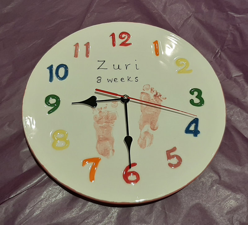 A new item for 2020, a ceramic clock. Personalised with baby footprints.