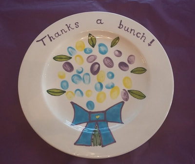 Dinner plate with a finger print bouquet of flowers.